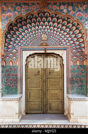 Paintings on a door in thr city palace in Jaipur, India - Stock Photo