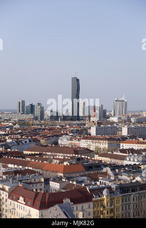 View over Vienna with skyline of Donau - Danube city centre in background - Stock Photo