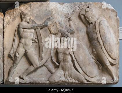 London. England. British Museum, Nereid Monument, frieze (detail), warriors in combat, from Xanthos, Turkey, ca. 390-380 B.C.  The Nereid Monument was - Stock Photo