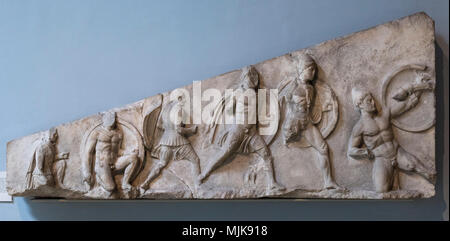 London. England. British Museum, Nereid Monument, frieze (detail), foot soldiers wearing Persian caps moving in battle, from Xanthos, Turkey, ca. 390- - Stock Photo
