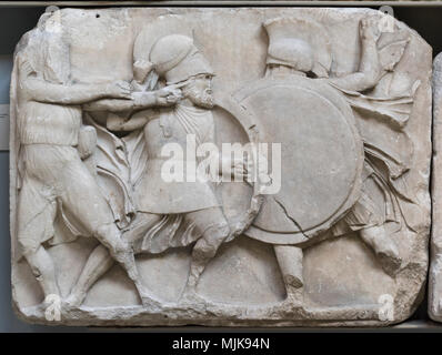 London. England. British Museum, Nereid Monument, frieze (detail), hoplite warriors in combat, and archer drawing a bow, from Xanthos, Turkey, ca. 390 - Stock Photo