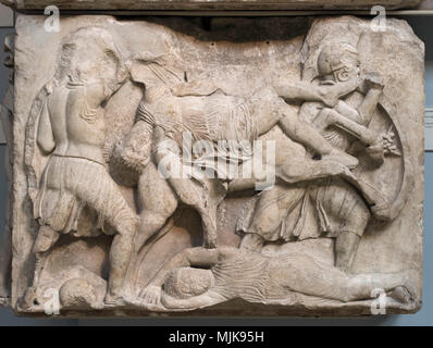 London. England. British Museum, Nereid Monument, frieze (detail), warriors in combat, dead man falling from a rearing horse, from Xanthos, Turkey, ca - Stock Photo