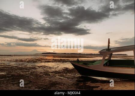 pleasure boat on low tide coastline tropical island - Stock Photo