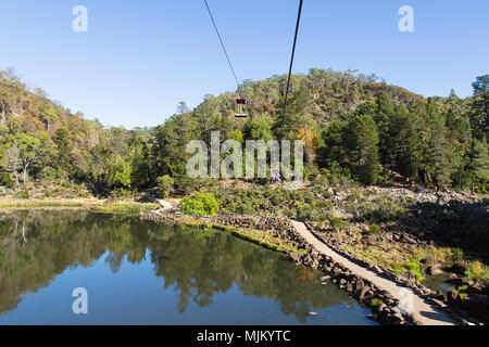 The chairlift over the first basin at Cataract Gorge in Launceston, Tasmania is the longest single-span chairlift in the world at 308m. - Stock Photo
