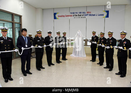 171207-N-TB148-048 CHINHAE, Republic of Korea (Dec. 07, 2017) Rear Adm. Brad Cooper, commander, U.S. Naval Forces Korea (CNFK), attends the unveiling of the Capt. Michael Lousey memorial bust unveiling ceremony at Republic of Korea (ROK) Naval Academy in Chinhae. CNFK is the U.S. Navy's representative in the ROK, providing leadership and expertise in naval matters to improve institutional and operational effectiveness between the two navies and to strengthen collective security efforts in Korea and the region. (U.S. Navy photo by Mass Communication Specialist Seaman William Carlisle) - Stock Photo
