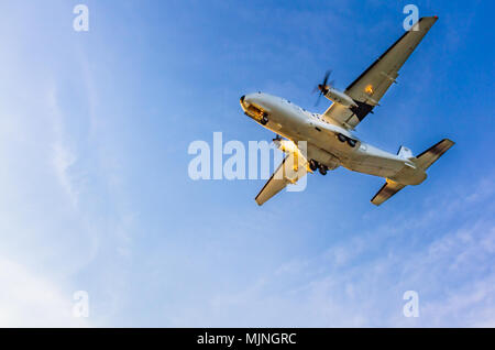 Turboprop air plane landing at Larnaca International Airport on a sunny afternoon - Stock Photo
