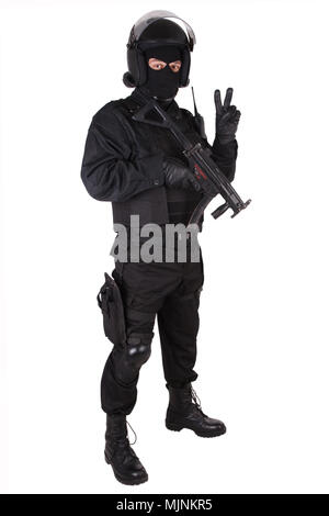 Riot police officer with weapon in black uniform isolated on white - Stock Photo