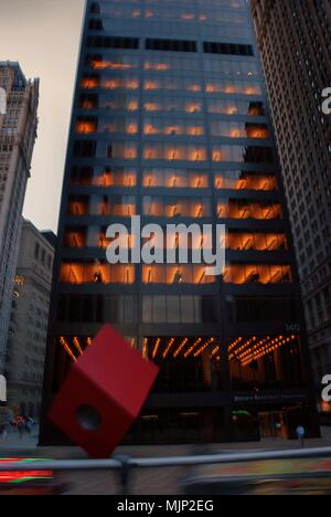 Isamu Noguchi's Red Cube in front of 140 Broadway in Lower Manhattan, New York - Stock Photo