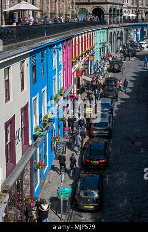 Looking down from Victoria Terrace onto the colourful shops of Victoria Street below in Edinburgh's Old Town. - Stock Photo