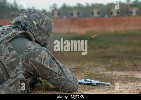 Fort Stewart, Ga., March 20, 2018 - Georgia Air National Guardsman Senior Master Sgt. David Taylor, security forces, 165th Security Forces Squadron, Savannah, Ga., engages a 100-meter target during the Georgia Army National Guard Small Arms Leader Course. The course specilizes in the tactics and techniques of engagement and training Guardsman in weapons use.  (Georgia Army National Guard Armed Forces and civilians displaying courage bravery dedication commitment and sacrifice