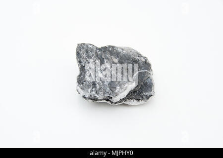 extreme close up with a lot of details of anhydrite mineral isolated over white background - Stock Photo