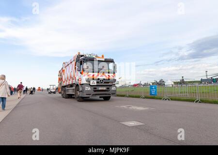 BERLIN / GERMANY - APRIL 28, 2018: German garbage truck from Berlin Recycling drives on airfield Schoenefeld. - Stock Photo