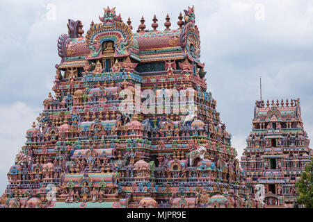 Two of the intricately carved and painted entrance gateways, or Gopurams, at the Ranganathaswamy temple at Srirangam at Trichy in Tamil Nadu - Stock Photo