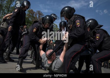 Moscow, Russia. 5th May, 2018. Russian police officers arrest a participant of an unauthorized opposition rally organized by the opposition leader Alexei Navalny, prior to the official inauguration of president Putin, in Moscow, Russia - Stock Photo