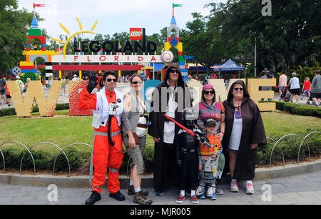 Winter Haven, Florida, USA, May 5, 2018.  People dressed as Star Wars characters pose for a photograph at the entrance to LEGOLAND Florida resort in Winter Haven, Florida on May 5, 2018, the first day of LEGO Star Wars Days. The event is scheduled for three consecutive weekends in May and features the Force Awakens MINILAND model display as well as life-sized LEGO sculptures of Star Wars characters. (Paul Hennessy/Alamy) - Stock Photo