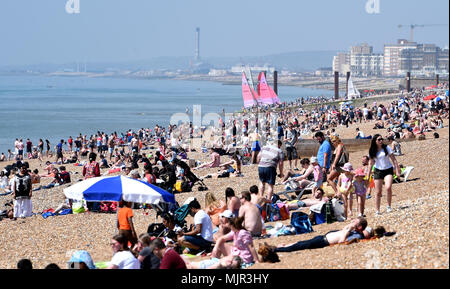 Brighton UK 6th May 2018  -  Brighton beach is packed before lunchtime as crowds flock to the south coast to enjoy the hot sunny weather Credit: Simon Dack/Alamy Live News - Stock Photo
