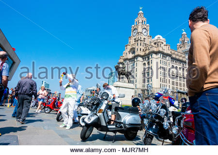 Mods and scooters at the Pier Head on the banks of the River Mersey, people gather in front of a load of mods with scooters in the sunshine in front of the Liver Building, on a sunny Bank Holiday Weekend, Liverpool, England UK Europe - Stock Photo