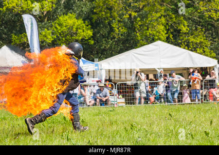 Netley Marsh, Hampshire, UK. 6th May 2018. The first day, of the two day event, Hampshire Game & Country Fair attracts the crowds on a hot sunny day. Stannage International Stunt Display Team thrill the crowds as a stuntman runs around the arena on fire. Credit: Carolyn Jenkins/Alamy Live News - Stock Photo