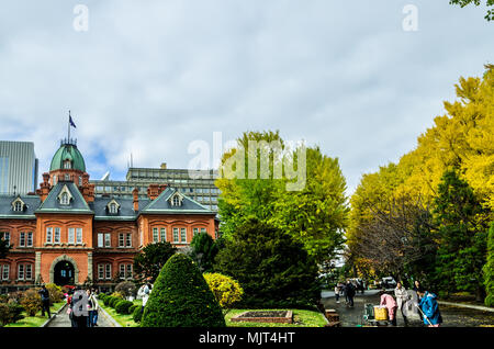 Sapporo Old City Hall during autumn. Trees surrounding the building change into fall colour and give this famous tourist hotspot a beautiful looks. - Stock Photo