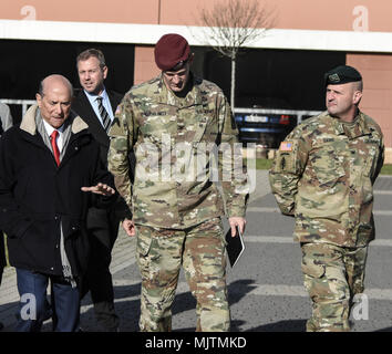 US Ambassador to Italy, Lewis Eisenberg, talks with 173rd Airborne Brigade commander, Colonel James Bartholomees about the role of the 'Sky Soldiers' in the defense of Europe. - Stock Photo