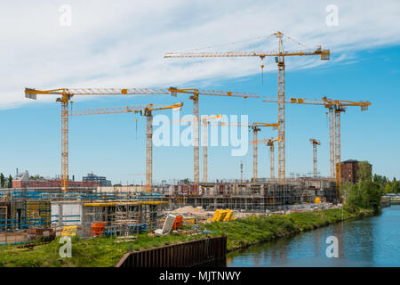 Berlin, Germany - may 2018: Many cranes on constuction site of the Quartier Europacity in Berlin, Germany - Stock Photo