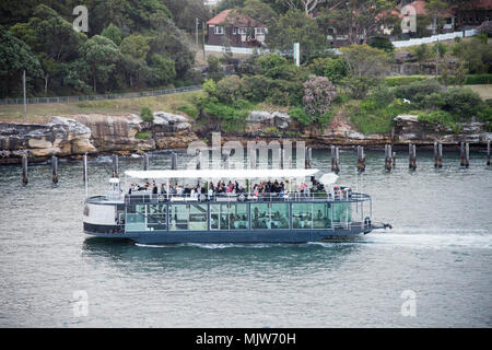 Sydney,NSW,Australia-December 7,2016: Tourists on boat cruising in the harbour at sunset in Sydney, Australia - Stock Photo