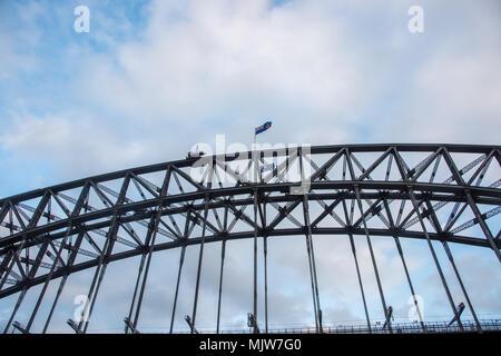 Sydney,NSW,Australia-December 7,2016: Detail of the steel through arch Sydney Harbour Bridge under a blue sky with clouds in Sydney, Australia - Stock Photo
