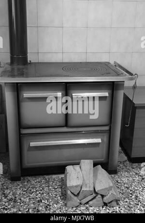 old stove in the kitchen with black and white effect - Stock Photo