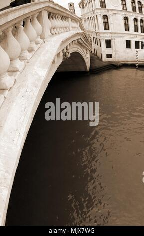 Rialto Bridge with fisheye lens in Venice Italy with sepia toned effect - Stock Photo