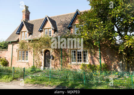 Attractive detached red brick historic house in village of Compton Bassett, Wiltshire, England, UK - Stock Photo