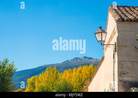 Peñalara peak from the village. Rascafria, Madrid province, Spain. - Stock Photo