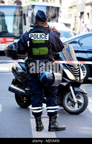 French Police Officer on traffic regulation - Paris - France - Stock Photo