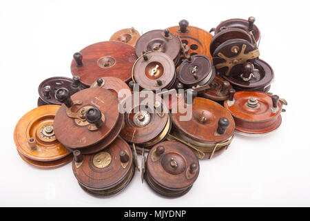 A collection of mostly wooden centrepin fishing reels from a large fishing tackle collection. Dorset England UK - Stock Photo