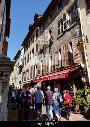 Crowd of tourists shopping in the narrow streets of old town,mAnnecy, France - Stock Photo
