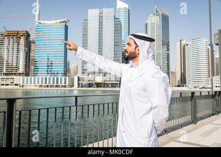 Arabic businessman wearing kandora - Portrait of traditional emirati man - Stock Photo