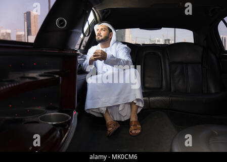 Arabic businessman wearing kandora - Portrait of traditional emirati man - Stock Photo