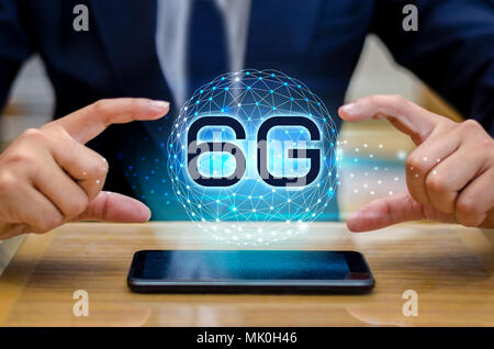 phone 6g Earth businessman connect worldwide waiter hand holding an empty digital tablet with smart and 6G network connection concept - Stock Photo