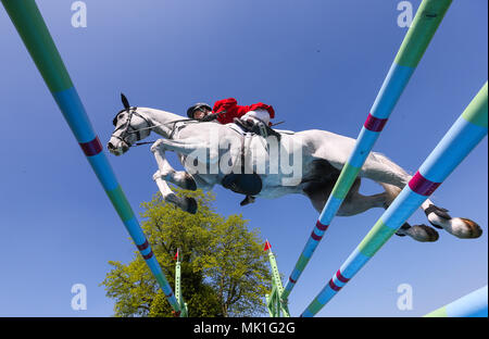 Harry Meade with Away Cruising jumps the last in the show jumping round during day five of the Mitsubishi Motors Badminton Horse Trials at The Badminton Estate, Gloucestershire. - Stock Photo