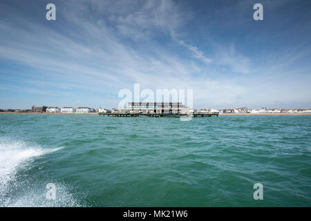 Deal Pier taken from a boat on the English Channel. - Stock Photo
