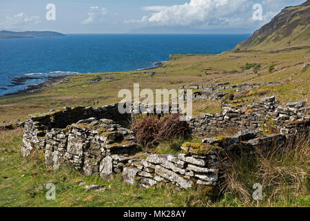 Ruins of old croft houses in the deserted coastal village of Boreraig, Isle of Skye, Scotland, UK - Stock Photo