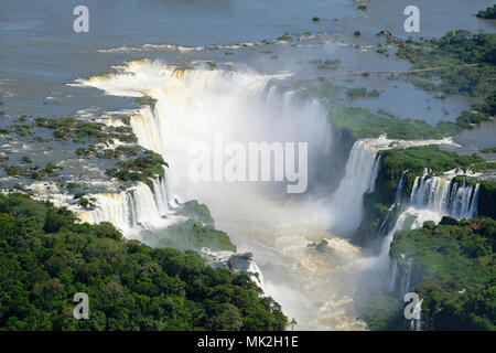 Aerial view of the Devil's Throat or Garganta del Diablo at Iguassu (Iguacu / Iguazu) falls on the border of Argentina and Brazil - Stock Photo
