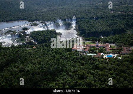 Aerial view of the Iguassu / Iguacu falls - the world's biggest waterfall system on the border of Brazil an Argentina, and the Belmond Cataratas hotel - Stock Photo