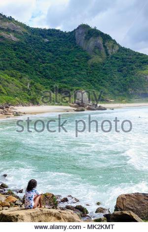 A beautiful young African Brazilian woman on Prainha beach, Rio de Janeiro, Brazil - Stock Photo