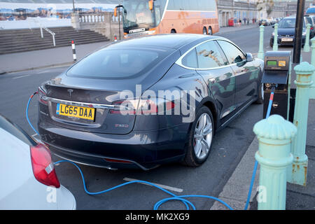 Brighton UK 6th May 2018  - Tesla car charging up at electric point on Brighton seafront - Stock Photo