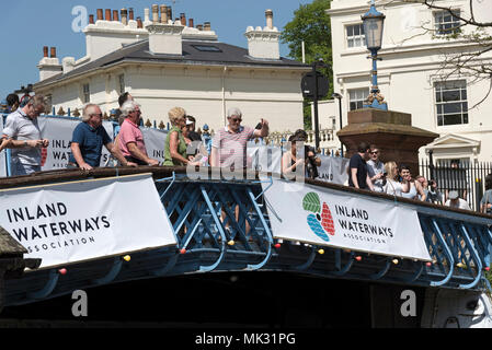 London, UK, 6 May 2018. Visitors standing on the Horse Bridge to watch the  Inland Waterways Association cavalcade at Little Venice, London  6 May 2018. Photo: Peter Titmuss - Stock Photo