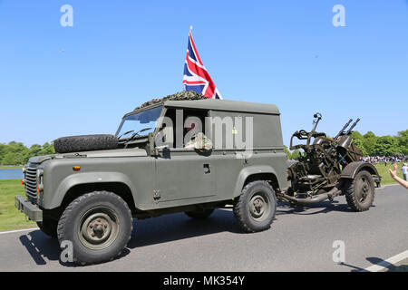 Land Rover towing ZPU-2 unit (twin 14.5mm anti-aircraft gun). Chestnut Sunday, 6th May 2018. Bushy Park, Hampton Court, London Borough of Richmond upon Thames, England, Great Britain, United Kingdom, UK, Europe. Vintage and classic vehicle parade and displays with fairground attractions and military reenactments. Credit: Ian Bottle/Alamy Live News - Stock Photo