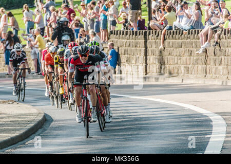 Leeds, UK - May 06, 2018: Cyclists taking part in Stage 4 of the Tour de Yorkshire pass cheering crowds in Leeds. Credit: colobusyeti.co.uk/Alamy Live News - Stock Photo