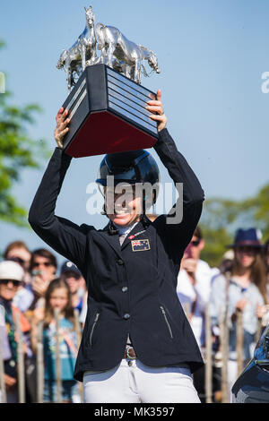 Gloucestershire, UK. 6th May, 2018. Jonelle Price (NZL) celebrates winning the Mitsubishi Motors Badminton Horse Trials after jumping a clear round on her mount Classic Moet following her storming round of Cross Country Yesterday. The smile says it all Jonelle who is married to fellow New Zealand three day eventer Tim Price had her first baby in August 2017. The couple are based near Marlborough in Wiltshire Credit: David Betteridge/Alamy Live News - Stock Photo