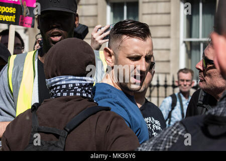London, UK. 6th May, 2018. Anti-fascists holding a counter-protest to the far-right Democratic Football Lads Alliance's 'Day of Freedom' event in Whitehall confront a man wearing a blue t-shirt. Credit: Mark Kerrison/Alamy Live News - Stock Photo