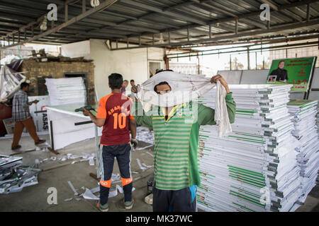 Baghdad, Iraq. 18th Apr, 2018. A picture made available on 07 May 2018 shows Bangladeshi migrant workers preparing election campaign posters in Baghdad, Iraq, 18 April 2018. The country gears up for parliamentary elections where about 7,000 candidates are vying for 329 parliamentary seats on May 12. Credit: Oliver Weiken/dpa/Alamy Live News - Stock Photo
